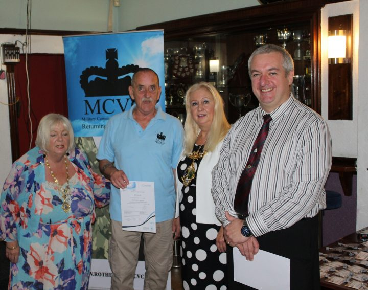 Bill Carroll receiving his certificate from The Mayor